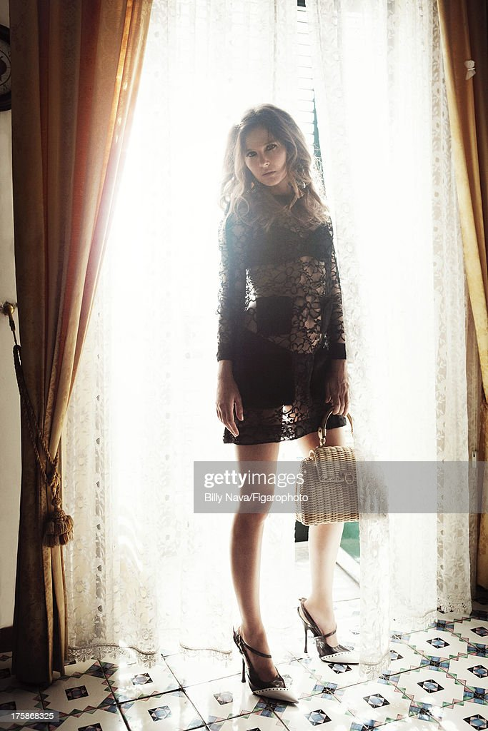 106843-008. Actress Virginie Ledoyen is photographed for Madame Figaro on July 12, 2013 in San Valentino Torio, Italy. Dress (Louis Vuitton), bra (Carine Gilson), earrings (Dolce & Gabbana), bag (Salvatore Ferragamo), shoes (Miu Miu). Make-up by Sisley. PUBLISHED IMAGE.