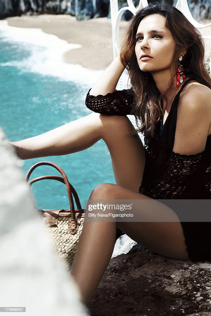 106843-013. Actress Virginie Ledoyen is photographed for Madame Figaro on July 12, 2013 in San Valentino Torio, Italy. Tunic (BA & SH), swimsuit (Andres Sarda), earrings (Gucci), necklace (Stone), bag (La Bagagerie). Make-up by Sisley. PUBLISHED IMAGE.