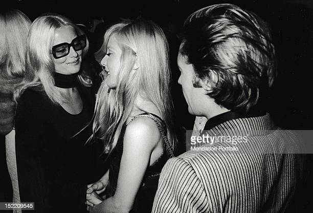 Actress Virna Lisi congratulates French singer Sylvie Vartan on her show performed at Paris' Olympia nearby actor Helmut Berger Paris 1970