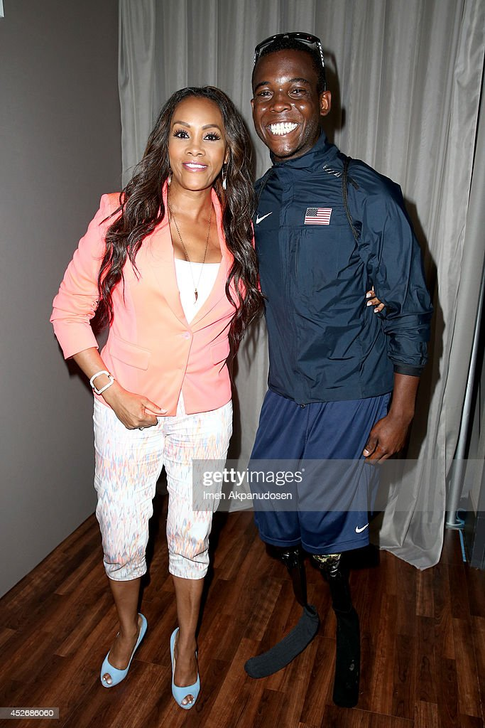 Actress Vivica A. Fox (L) and Paralympic athlete Blake Leeper attend the Samsung Galaxy VIP Lounge at Comic-Con International 2014 at Hard Rock Hotel San Diego on July 25, 2014 in San Diego, California.