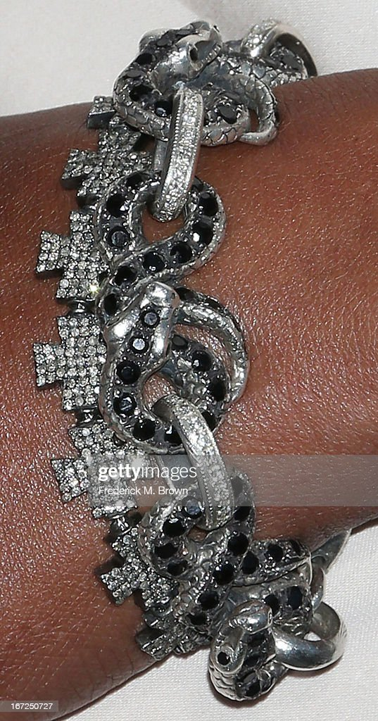Actress Vivica A. Fox (jewellery detail) attends the premiere of Paramount Pictures' 'Pain & Gain' at the TCL Chinese Theatre on April 22, 2013 in Hollywood, California.
