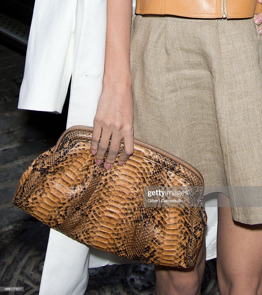 Actress Wang Luodan (purse detail) attends Michael Kors fashion show during Fall 2014 Mercedes - Benz Fashion Week on February 12, 2014 in New York City.