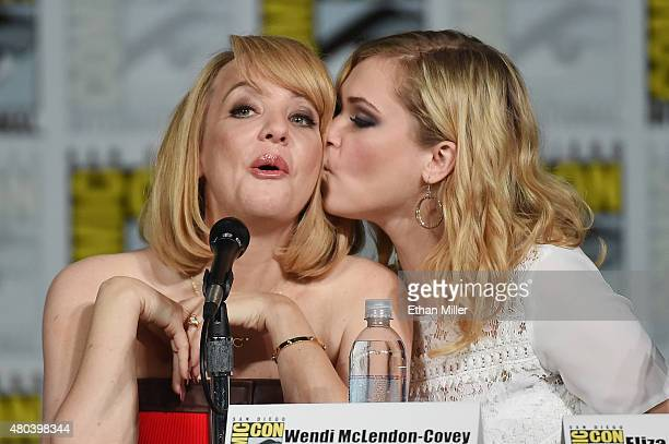Actress Wendi McLendonCovey is kissed by actress Eliza Taylor at the TV Guide Magazine Fan Favorites panel during ComicCon International 2015 at the...