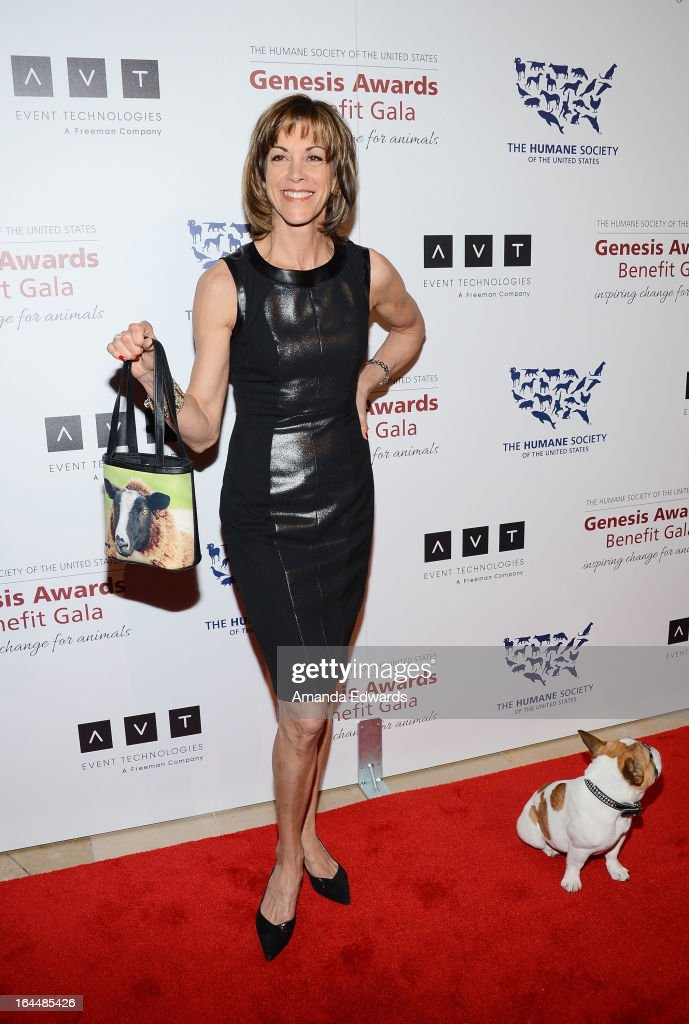 Actress Wendie Malick and Beatrice the dog arrive at The Humane Society's 2013 Genesis Awards Benefit Gala at The Beverly Hilton Hotel on March 23, 2013 in Beverly Hills, California.