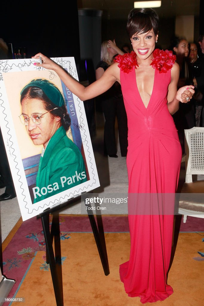Actress Wendy Raquel previews the Rosa Parks Forever Stamp in the U.S. Postal Service Civil Rights Stamp Gallery backstage at the NAACP Image Awards on February 1, 2013 at The Shrine Auditorium.