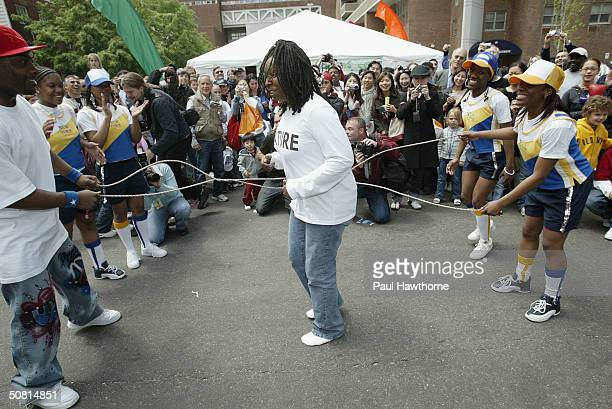 Actress Whoopi Goldberg jumps rope with double dutch team Jumpers N Command of Brooklyn New York at the Family Festival Street Fair during the 2004...