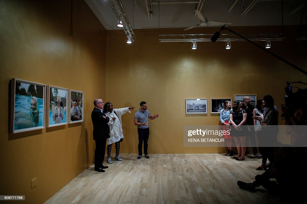 US actress Whoopi Goldberg speaks during a press preview for Marilyn Monroe's iconic 'Happy Birthday Mr. President' dress and other items at MANA Contemporary Museum in Jersey City, New Jersey on September 22, 2016. Julien's Auctions is offering the sequined dress for auction in Los Angeles on November 17, 2016. / AFP / KENA