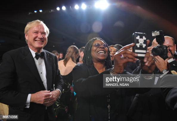 Actress Whoopi Goldberg takes a photo of US President Barack Obama with her cell phone at the White House Correspondents� Association annual dinner...