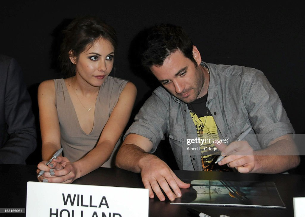 Actress Willa Holland and actor Colin Donnell of The WB's 'Arrow' signs autographs at the DC Comics booth at WonderCon Anaheim 2013 - Day 3 held at Anaheim Convention Center on March 31, 2013 in Anaheim, California.
