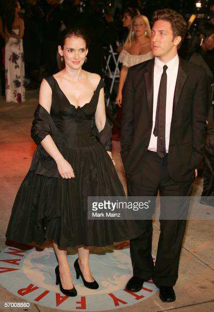 Actress Winona Ryder and her date arrives at the Vanity Fair Oscar Party at Mortons on March 5 2006 in West Hollywood California