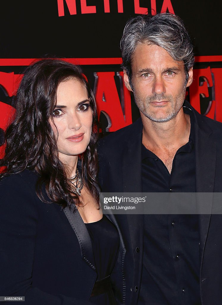 Actress Winona Ryder (L) and Scott Mackinlay Hahn attend the premiere of Netflix's 'Stranger Things' at Mack Sennett Studios on July 11, 2016 in Los Angeles, California.