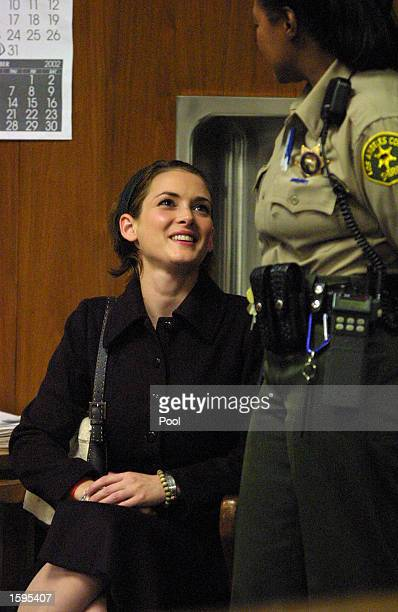 Actress Winona Ryder listens as the verdict is read at the Beverly Hills Municipal Court on the eighth day of her shoplifting trial on November 6...