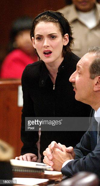 Actress Winona Ryder reacts in court during her sentencing hearing for shoplifting at the Beverly Hills Municipal Court on December 6 2002 in Beverly...