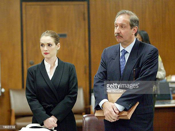 Actress Winona Ryder with her attorney Mark Geragos appears at Beverly Hills Superior court after a progress report following her conviction for...