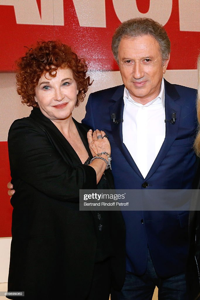 Actress, writer and strip cartoon autor (20 million of strip cartoon sold) Marlene Jobert and presenter of the show <a gi-track='captionPersonalityLinkClicked' href=/galleries/search?phrase=Michel+Drucker&family=editorial&specificpeople=769504 ng-click='$event.stopPropagation()'>Michel Drucker</a> attend the 'Vivement Dimanche' French TV Show special Album 'La bande a Renaud, volume 2'. Held at Pavillon Gabriel on December 3, 2014 in Paris, France.