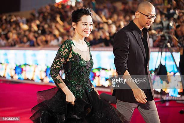 Actress Xu Qing and director Guan Hu arrive at the red carpet of the closing ceremony of the 25th China Golden Rooster Hundred Flowers Film Festival...