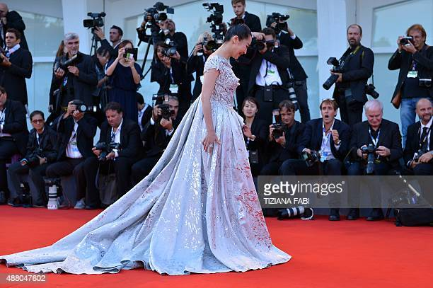 Actress Xu Qing arrives for the awards ceremony on the closing day of the 72nd Venice Film Festival on September 12 2015 at Venice Lido AFP PHOTO /...