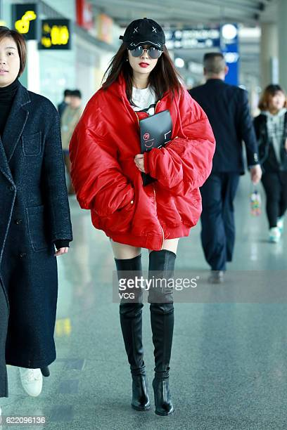 Actress Yang Mi arrives at the Beijing Capital International Airport on November 9 2016 in Beijing China