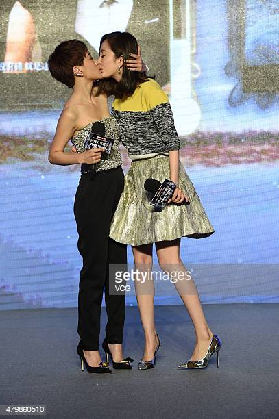 Actress Yang Mi kisses singer and actress Amber Kuo during the press conference for director Guo Jingming's new film 'Tiny Times 40' premiere on July...
