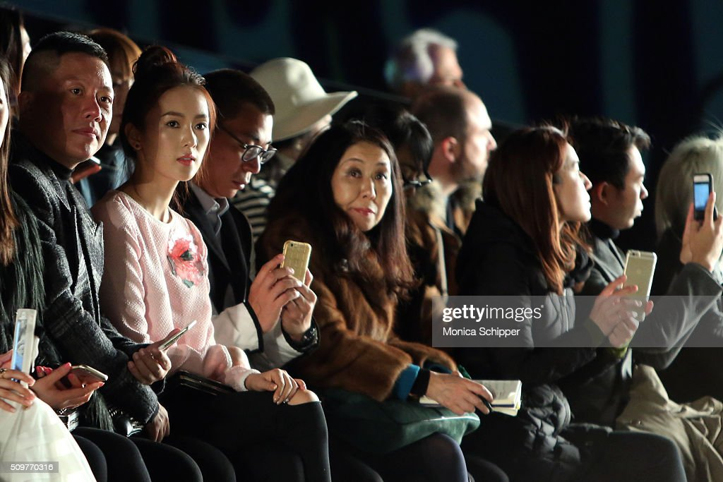 Actress Yao Tong(2ndL) attends the Tadashi Shoji Fall 2016 fashion show during New York Fashion Week: The Shows at The Arc, Skylight at Moynihan Station on February 12, 2016 in New York City.
