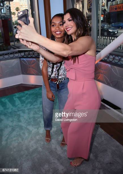 Actress Yara Shahidi and actress/host Ali Landry pose for a selfie at Hollywood Today Live at W Hollywood on April 27 2017 in Hollywood California