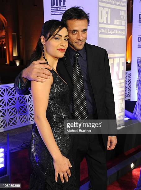 Actress Yasmine Al Massri and actor Alexander Siddig arrive at the 'Miral' premiere during the 2010 Doha Tribeca Film Festival held at the Katara...