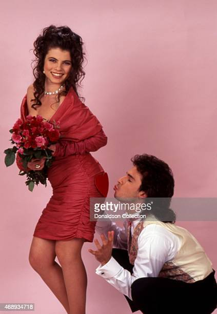 Actress Yasmine Bleeth poses for a portrait session with actor Ricky Paull Goldin in 1995 in Los Angeles California