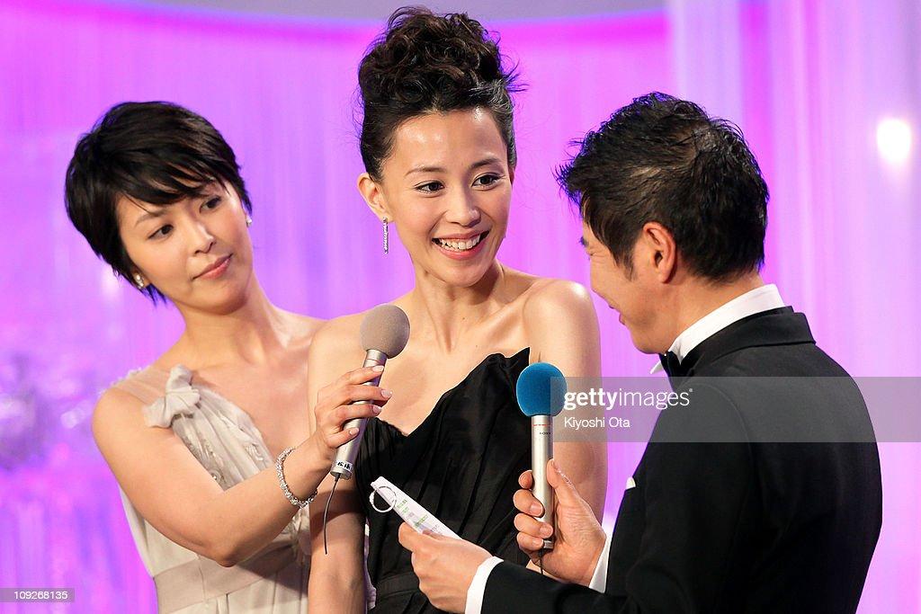 Actress Yoshino Kimura (C) attends the 34th Japan Academy Aawrds at Grand Prince Hotel New Takanawa on February 18, 2011 in Tokyo, Japan.