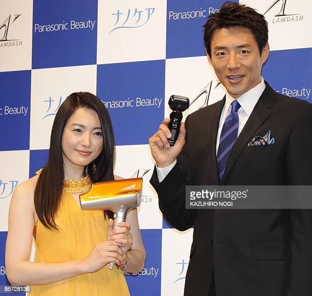 Actress Yukie Nakama and sport commentator Shuzo Matsuoka display new products UVs care hair dryer 'EHNA91' and men's electronic shaver Lamdash...