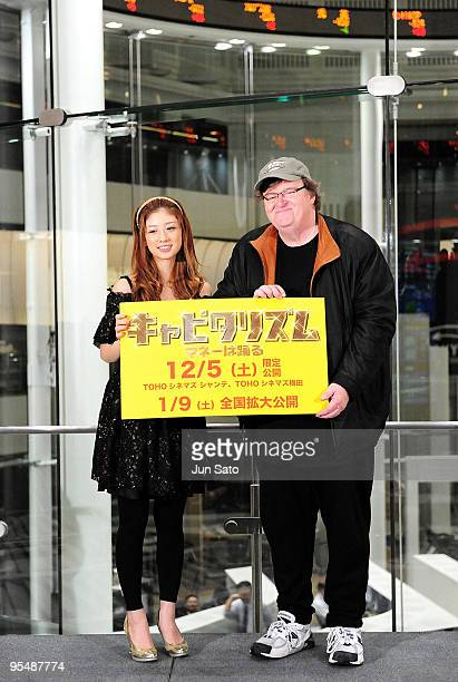 Actress Yuko Ogura and director Michael Moore attend 'Capitalism A Love Story' Press Conference at Tokyo Stock Exchange on November 30 2009 in Tokyo...