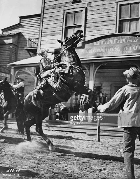 Actress Yvonne de Carlo performing her own stunts on horseback on the set of a western film in Hollywood CA circa 1955