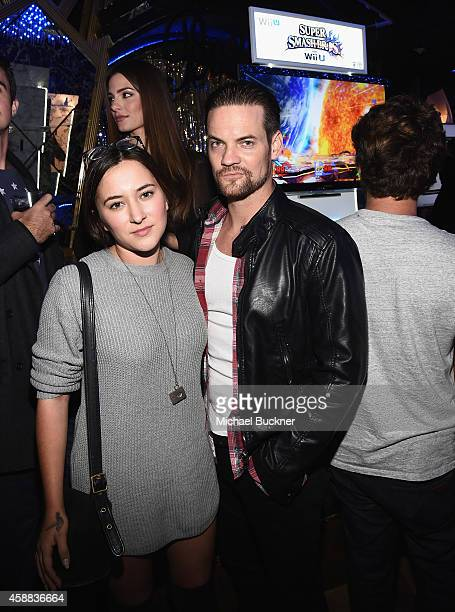 Actress Zelda Williams and actor Shane West enjoy the festivities during the Super Smash Bros for Wii U event on November 11 2014 in Los Angeles...