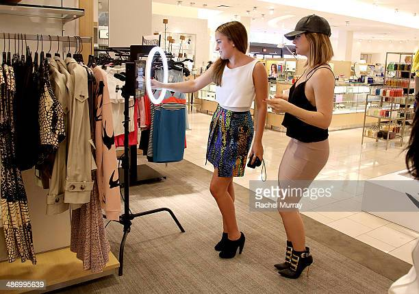 Actress Zelda Williams and singer JoJo visit the photo booth during Neiman Marcus and Teen Vogue celebrate McQ's Spring Collection hosted by Zelda...