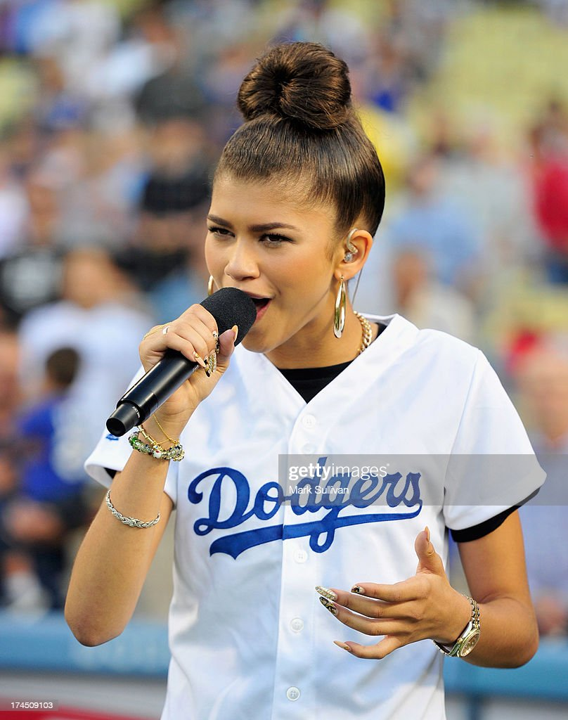 Actress Zendaya sings the national anthem before the MLB game between the Cincinnatti Reds and Los Angeles Dodgers at Dodger Stadium at Dodger Stadium on July 26, 2013 in Los Angeles, California.