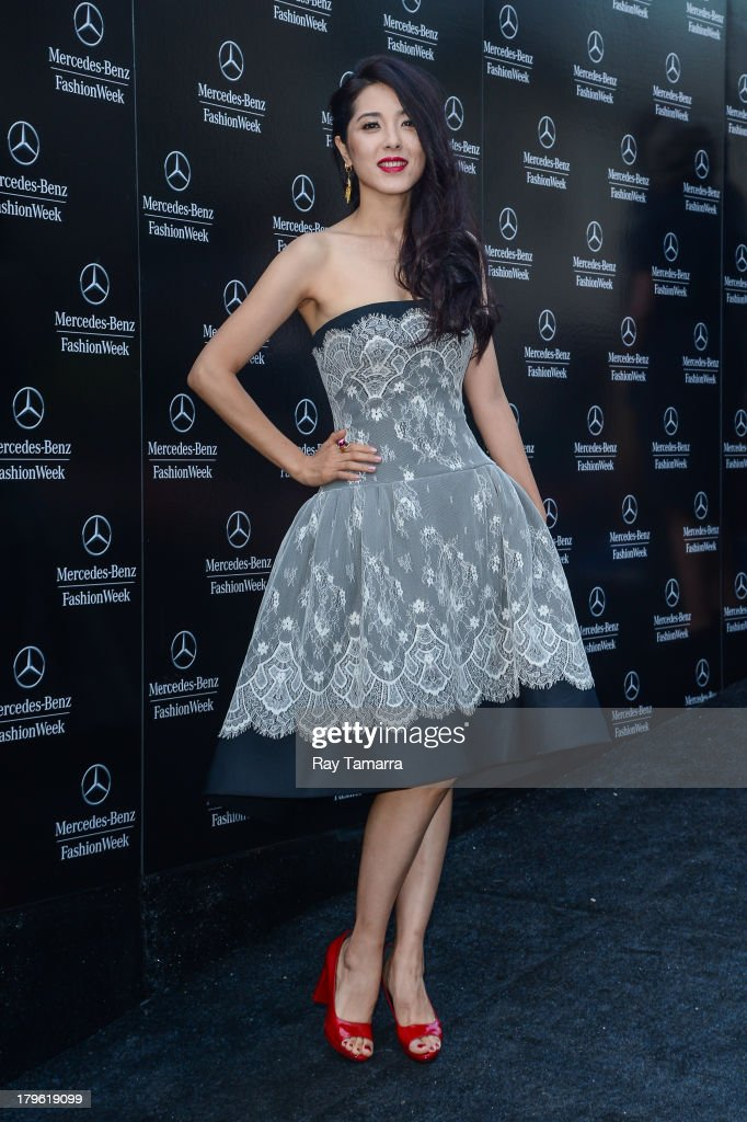 Actress Zeng Li enters Mercedes-Benz Fashion Week at Lincoln Center on September 5, 2013 in New York City.
