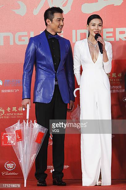 Actress Zhang Lanxin and actor Hu Bing arrive at the closing ceremony of 16th Shanghai International Film Festival at Shanghai Culture Square on June...
