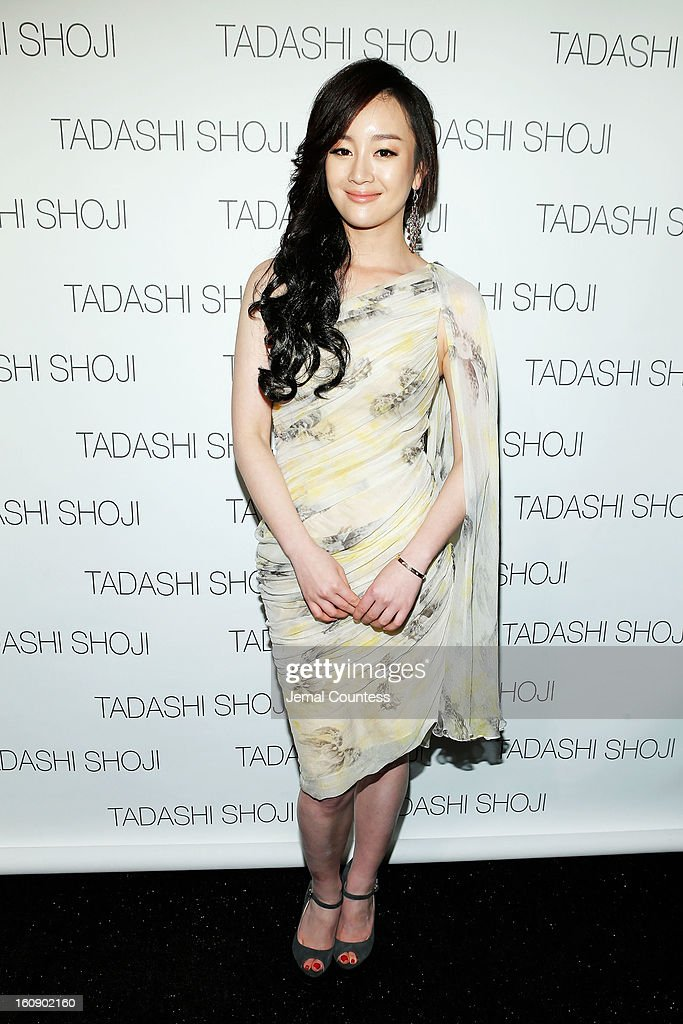 Actress Zhang Meng poses backstage at the Tadashi Shoji Fall 2013 fashion show during Mercedes-Benz Fashion Week at The Stage at Lincoln Center on February 7, 2013 in New York City.