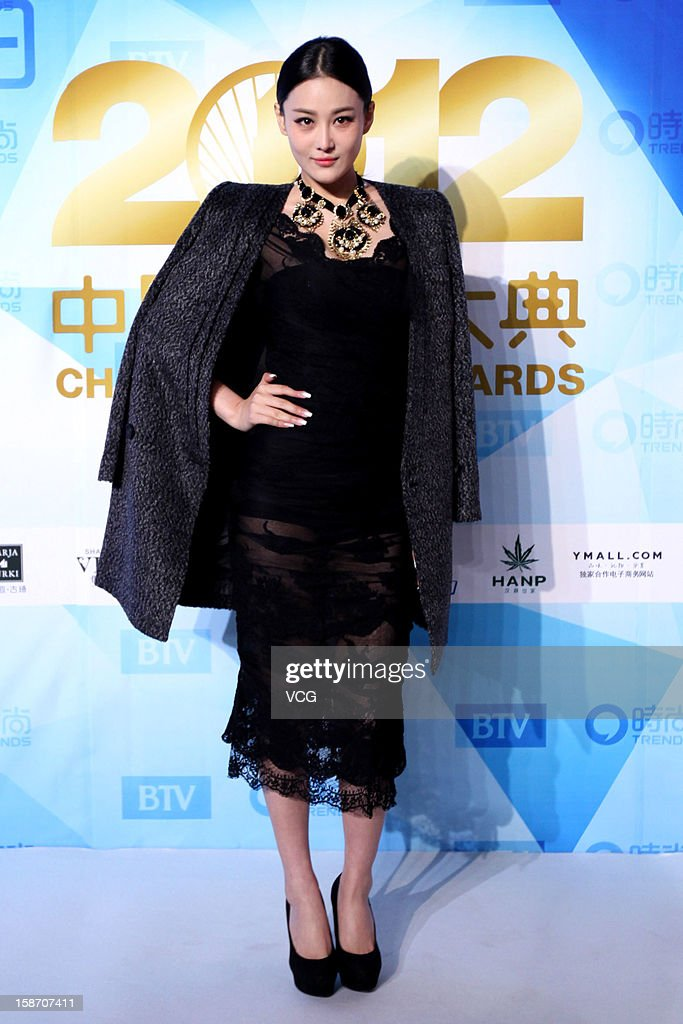 Actress Zhang Xinyu arrives at the red carpet of the 2012 China Trends Awards at BTV Grand Theater on December 22, 2012 in Beijing, China.