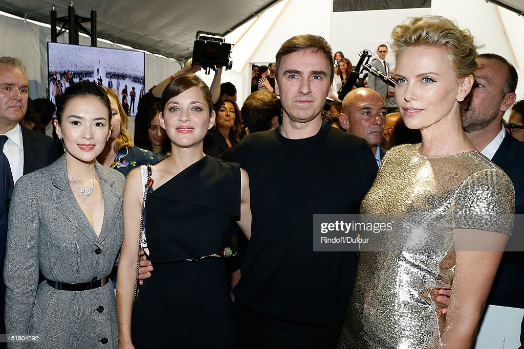 Actress Zhang Ziyi, actress Marion Cotillard, Fashion designer Raf Simons and Actress Charlize Theron pose backstage after the Christian Dior show as part of Paris Fashion Week - Haute Couture Fall/Winter 2014-2015. Held at Musee Rodin on July 7, 2014 in Paris, France.