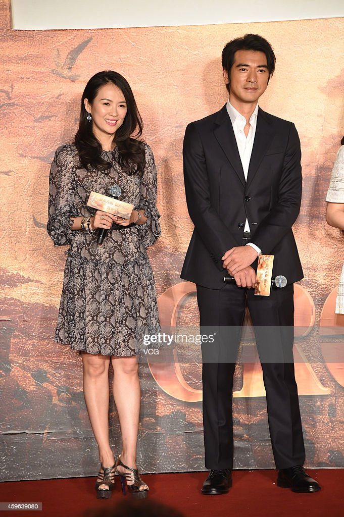 Actress Zhang Ziyi and actor <a gi-track='captionPersonalityLinkClicked' href=/galleries/search?phrase=Takeshi+Kaneshiro&family=editorial&specificpeople=171924 ng-click='$event.stopPropagation()'>Takeshi Kaneshiro</a> attend press conference for movie 'The Crossing' on November 27, 2014 in Beijing, China.