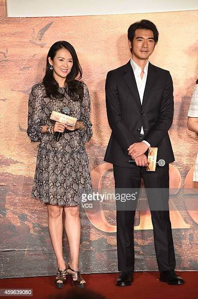Actress Zhang Ziyi and actor Takeshi Kaneshiro attend press conference for movie 'The Crossing' on November 27 2014 in Beijing China