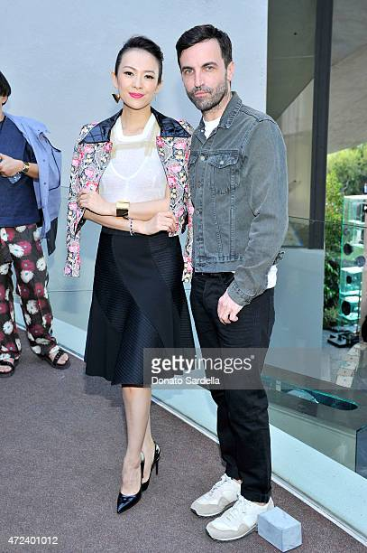 Actress Zhang Ziyi and designer Nicolas Ghesquiere backstage at the Louis Vuitton Cruise 2016 Resort Collection shown at a private residence on May 6...