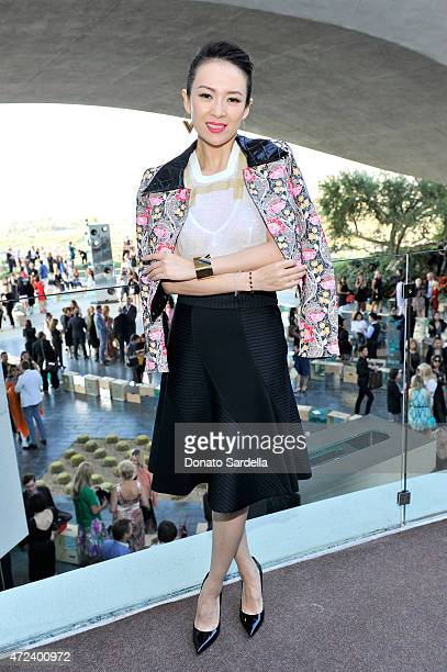 Actress Zhang Ziyi backstage at the Louis Vuitton Cruise 2016 Resort Collection shown at a private residence on May 6 2015 in Palm Springs California