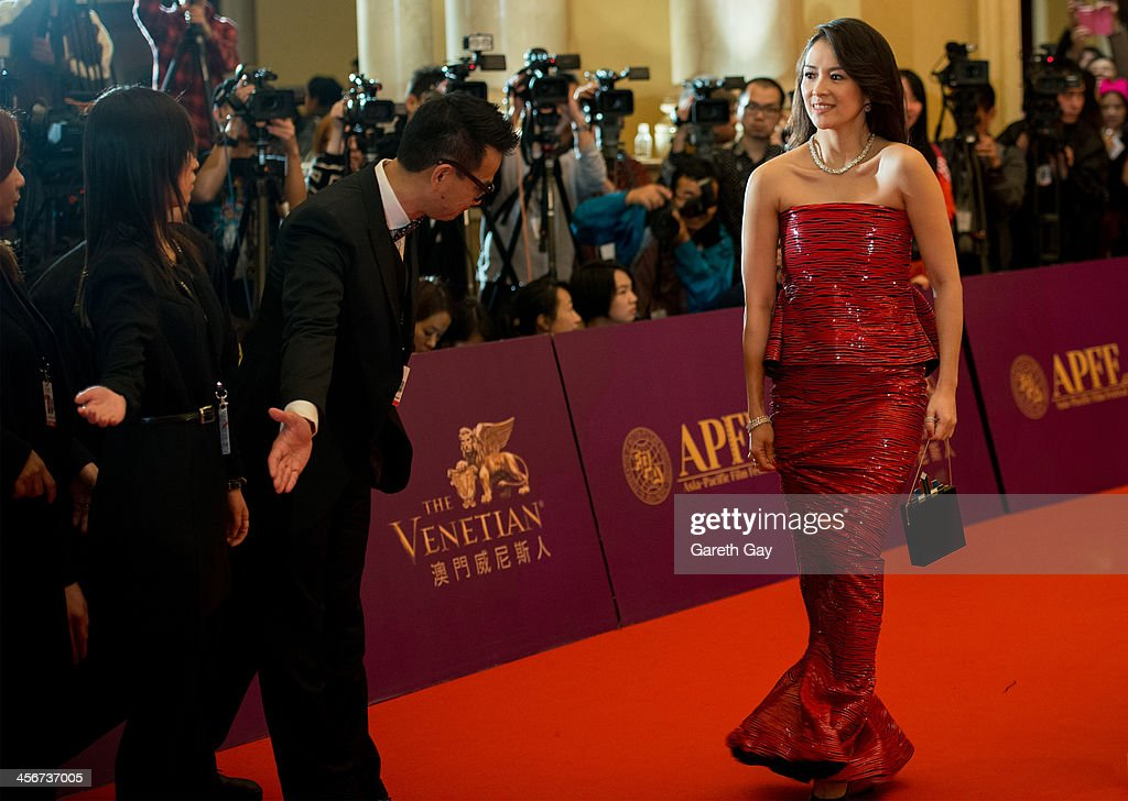 Actress Zhang Ziyi walks the red carpet to attend the awards ceremony during the last day of the 56th Asia Pacific Film Festival at The Venetian Hotel and Casino on December 15, 2013 in Macao.