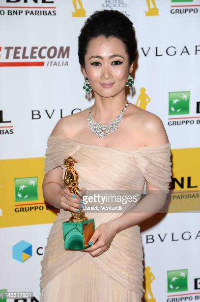 Actress Zhao Tao poses with the David di Donatello prize for Best Actress during the 'Premi David di Donatello' awards ceremony at the Auditorium...