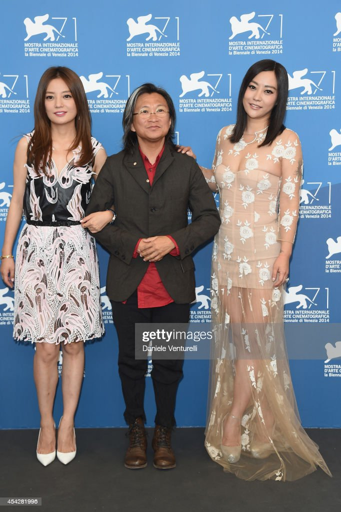 Actress <a gi-track='captionPersonalityLinkClicked' href=/galleries/search?phrase=Zhao+Wei&family=editorial&specificpeople=540140 ng-click='$event.stopPropagation()'>Zhao Wei</a>, director <a gi-track='captionPersonalityLinkClicked' href=/galleries/search?phrase=Peter+Chan&family=editorial&specificpeople=582345 ng-click='$event.stopPropagation()'>Peter Chan</a> and actress Lei Hao attend 'Dearest' (Quin'ai De) Photocall during the 71st Venice Film Festival at Palazzo Del Casino on August 28, 2014 in Venice, Italy.