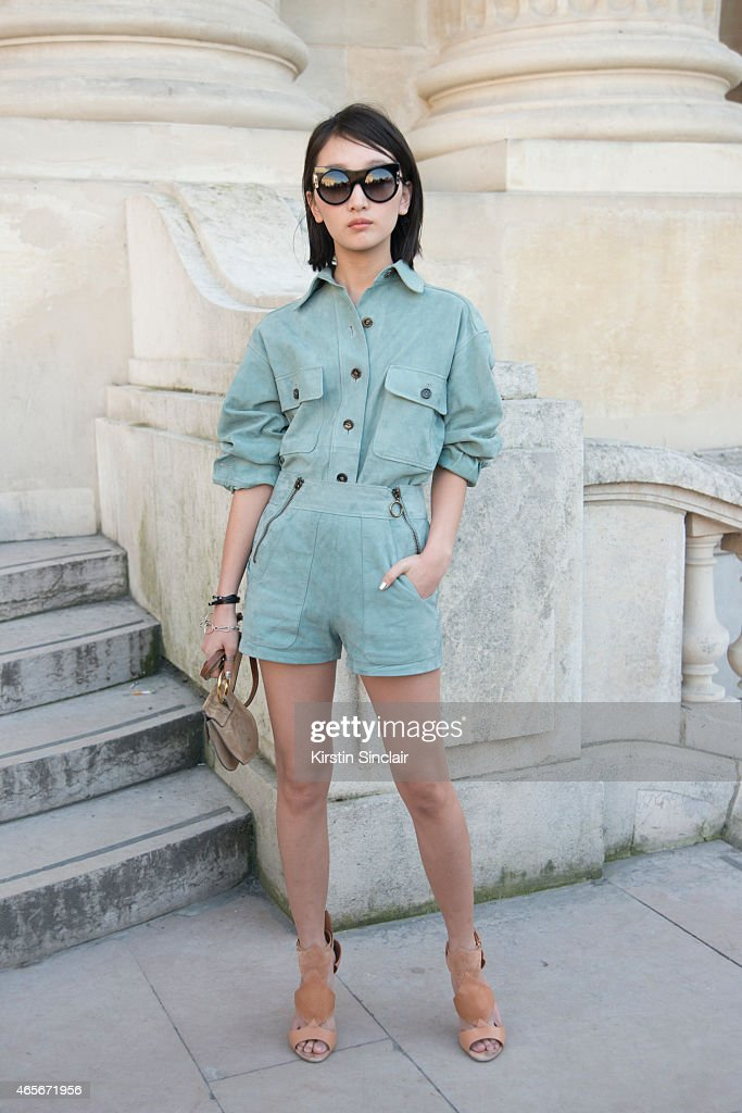Actress Zhou Dongyu wears a Chloe jumpsuit bag and shoes at the Chloe show on day 6 of Paris Collections Women on March 08 2015 in Paris France