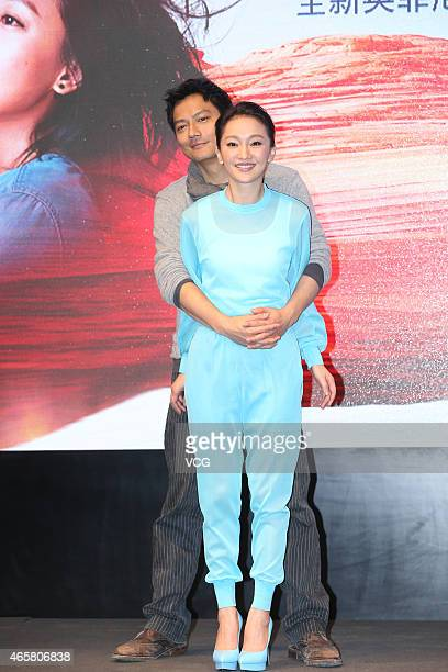 Actress Zhou Xun and her husband actor Archie Kao attend press conference of micro film 'Dream Escape' on March 10 2015 in Beijing China
