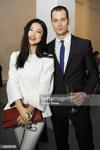 Actress Zhu Zhu and Jeremy O'Shea pose for pictures during the Calvin Klein special dinner at the Long March Space in 798 Art District on November 12...