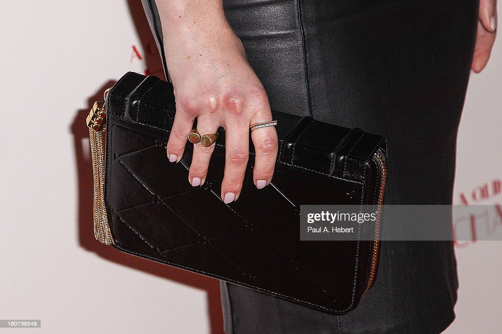 Actress Zoe Lister-Jones (clutch detail) arrives at the premiere of A24's 'A Glimpse Inside The Mind of Charles Swan III' held at the ArcLight Hollywood on February 4, 2013 in Hollywood, California.